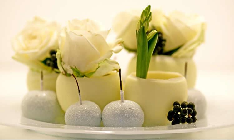 Maak je eigen bloempotjes met kaarsvet