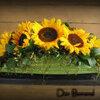 Bloemschikken: Maken van een bloemstuk voor op tafel in veranda of tuinterras