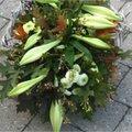 Herfstbloemstuk met lelies