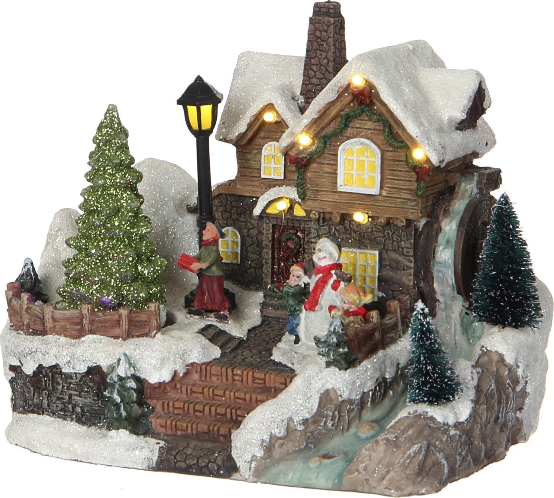 Kersthuis besneeuwd dak
