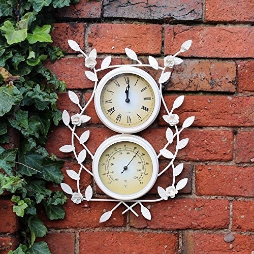 Klok en thermometer met bloemenframe
