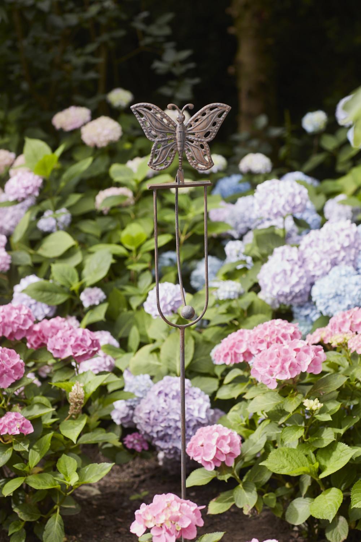 Schommelsteker vlinder vintage