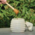 Honingpot met houten lepel