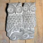 Muurdecoratie in steen - koppel uilen