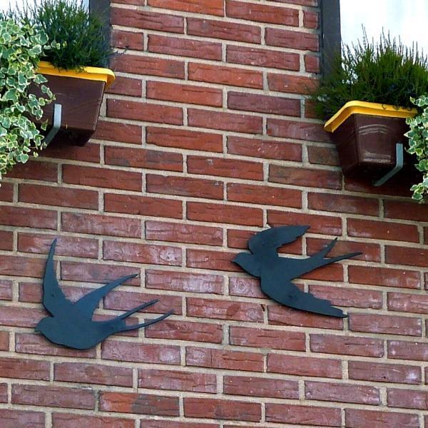 set van twee gietijzeren zwaluwen als muurdecoratie kopen